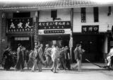 Chengdu (China), American soldiers walking on busy city street