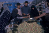 Esfahan province (Iran), people at open-air fruit stall