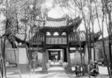 China, view of school through ornate gateway