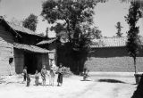 China, American soldier and children in a courtyard