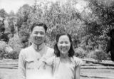 China, Chinese soldier and woman smiling for camera