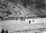 China, men on horses crossing Karakash river