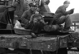 China, refugees sitting on train car, evacuation to Nanjing during the Civil War of 1949
