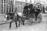 Nanjing (China), horse-drawn carriage filled with passengers, Civil War of 1949