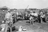 Shanghai (China), soldiers gathered around a horse-drawn cart loaded with supplies during Civil...