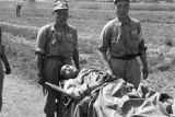 Shanghai (China), Nationalist soldiers carrying a wounded solider on a stretcher during Civil War...