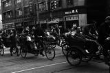 Shanghai (China), crowded streets with rickshaw traffic during the Civil War of 1949