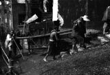 China, one of several images of men moving a piano