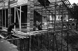 China, construction of a building in a city damaged by war