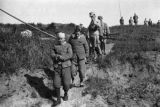 China, group of soldiers walking down dirt path