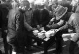 China, men surrounding small outdoor table