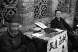 China, men tending a display table