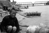 Lanzhou (China), portrait of a boy with inflated sheepskin rafts