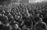 Changde (China), returning refugees wait to receive assistance at an assembly after the Battle of...