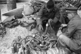 Changde (China), Chinese and foreign military officials looking at gas masks taken from Japanese...