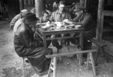 Changde (China), wounded reporter Selwyn Speight and colleagues break for tea while reporting on...