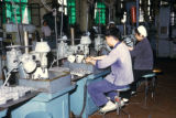 Luoyang, workers gearing machines in tractor plant
