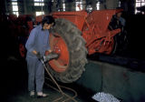 Luoyang, workers assembly line in tractor plant