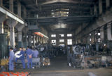 Luoyang, workers in mining machinery factory