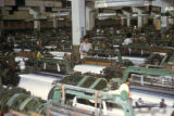 Shanghai, machinery and workers in textile mill