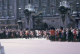 London, Buckingham Palace with spectators watching the Royal Band during guard change