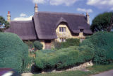 Chipping Campden, thatched roof home typical of Cotswold area