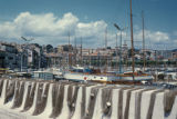Cannes, fish nets hung over wall in harbor