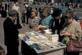 Moscow, vendor selling books along busy street