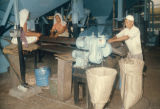 Kelang, workers bagging roasted palm kernels