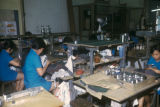 Tawau, women at work in pewter workshop