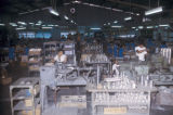 Tawau, pewter workers in large industrial facility