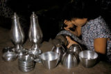 Tawau, worker hand-shaping pewter