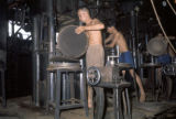 Singapore, workers using sesame oil presses