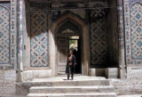 Samarkand, man at entrance to mosque
