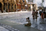 Rangoon, woman praying at Shwedagon Pagoda