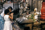 Rangoon, woman and child at shrine
