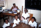 Lagos, primary school teacher and students in classroom