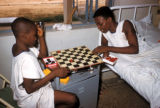 Kano, boys playing checkers in hospital