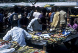 Abidjan, street vendors selling garments at market