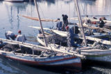 Sfax, fishermen working on boats in harbor