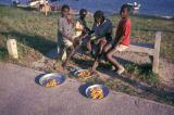 Dar es Salaam, boys selling corn bread near waterfront
