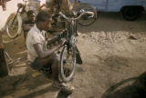 Dakar, men repairing bicycles
