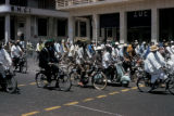 Dakar, bike riders on city street