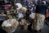 Dakar, women selling small wooden sticks, used as toothbrushes