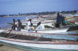 Dakar, men with fishing boats on beach