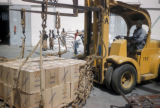 Dakar, worker operating forklift to carry boxes