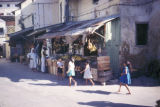 Zanzibar, street scene with children near fruit stand