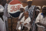 Khartoum, children on bikes near Pepsi sign
