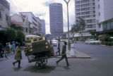 Nairobi, street vendor pulling cart along commercial street