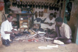Nairobi, shoemaker and assistants at work